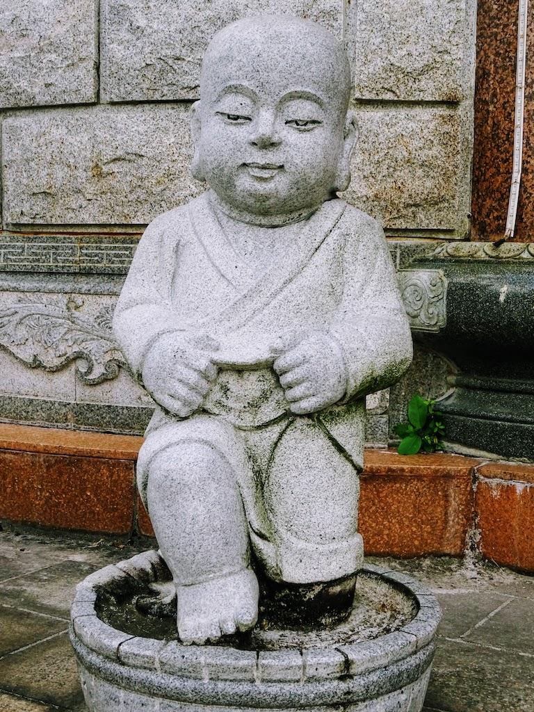 Malaisie Penang Kek Lok Si statue moine